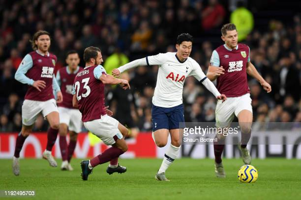 HeungMin Son of Tottenham Hotspur breaks past Erik Pieters of Burnley to go on and score his team's third goal during the Premier League match...