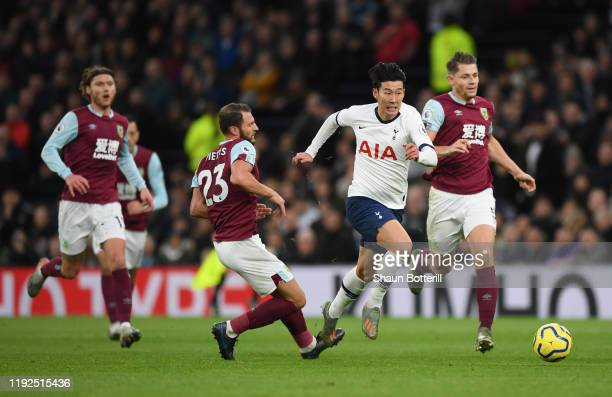 Heung-Min Son of Tottenham Hotspur breaks past Erik Pieters of Burnley to go on and score his team's third goal during the Premier League match...
