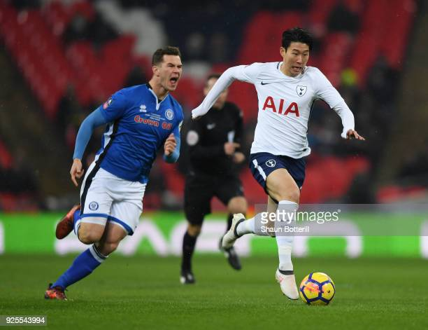 HeungMin Son of Tottenham Hotspur breaks past Harrison McGahey of Rochdale during the Emirates FA Cup Fifth Round Replay match between Tottenham...