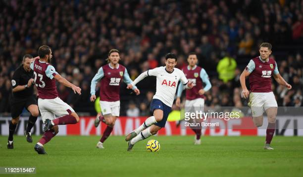 HeungMin Son of Tottenham Hotspur breaks to score his team's third goal during the Premier League match between Tottenham Hotspur and Burnley FC at...