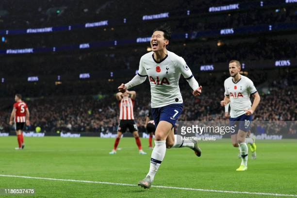 Heung-Min Son of Tottenham Hotspur celebrates after he scores his sides first goal during the Premier League match between Tottenham Hotspur and...