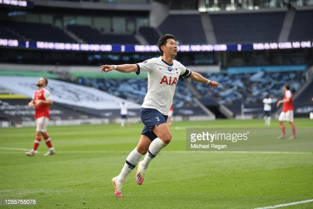 Heung-Min Son of Tottenham Hotspur celebrates after he scores his teams first goal during the Premier League match between Tottenham Hotspur and...