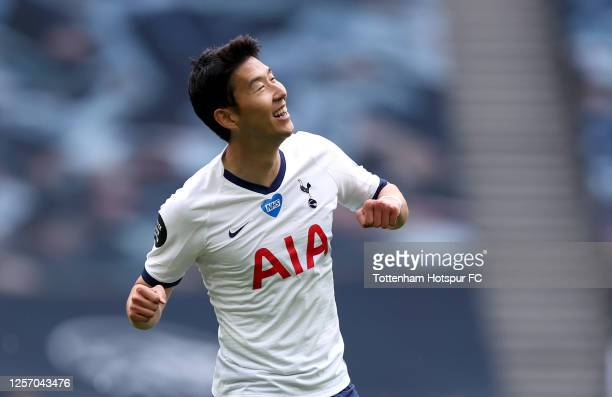 Heung-Min Son of Tottenham Hotspur celebrates after his shot on goal resulted in James Justin of Leicester city scoring an own goal to give Tottenham...