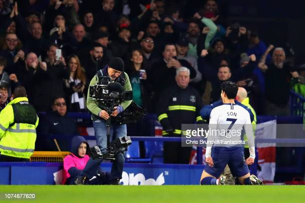 HeungMin Son of Tottenham Hotspur celebrates after scoring his sides fifth goal during the Premier League match between Everton FC and Tottenham...