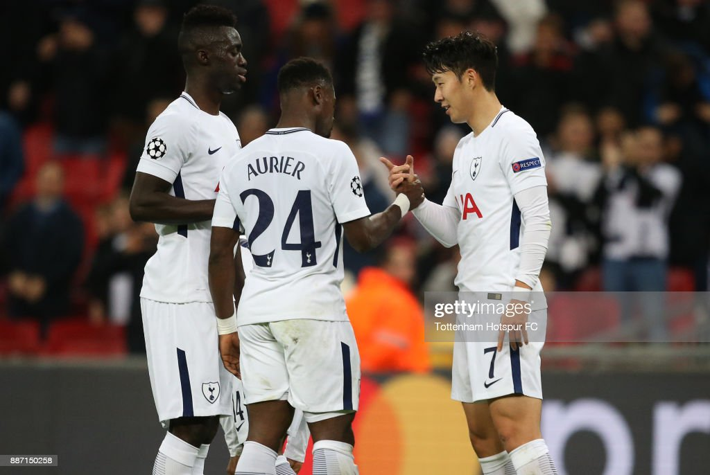 Heung-Min Son of Tottenham Hotspur celebrates after scoring his sides second goal with Serge Aurier of Tottenham Hotspur and Davinson Sanchez of Tottenham Hotspur during the UEFA Champions League group H match between Tottenham Hotspur and APOEL Nicosia at Wembley Stadium on December 6, 2017 in London, United Kingdom.
