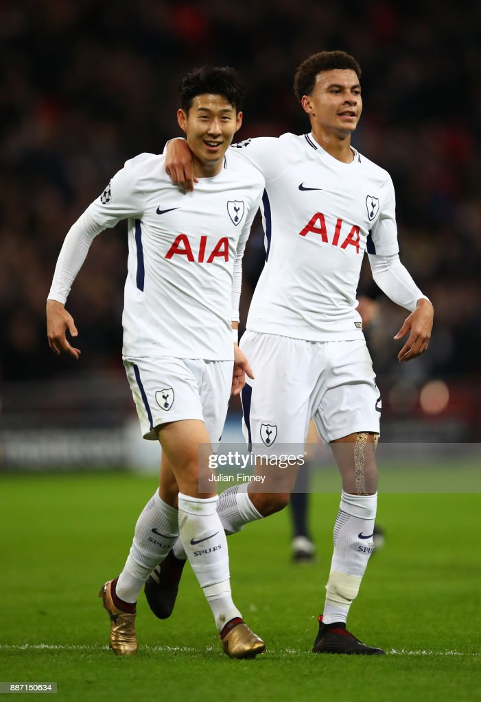 Heung-Min Son of Tottenham Hotspur celebrates after scoring his sides second goal with Dele Alli of Tottenham Hotspur during the UEFA Champions League group H match between Tottenham Hotspur and APOEL Nicosia at Wembley Stadium on December 6, 2017 in London, United Kingdom.
