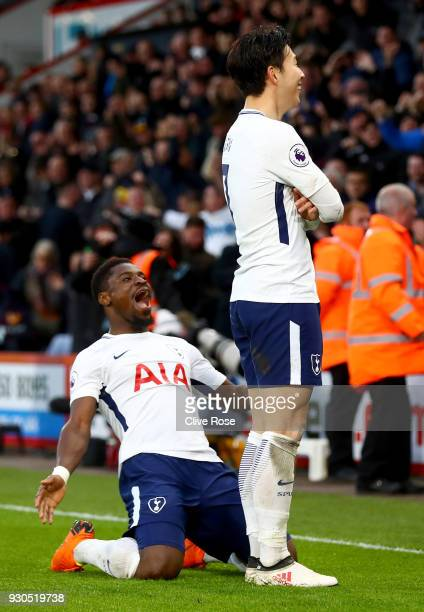 HeungMin Son of Tottenham Hotspur celebrates after scoring his sides third goal with Serge Aurier of Tottenham Hotspur during the Premier League...