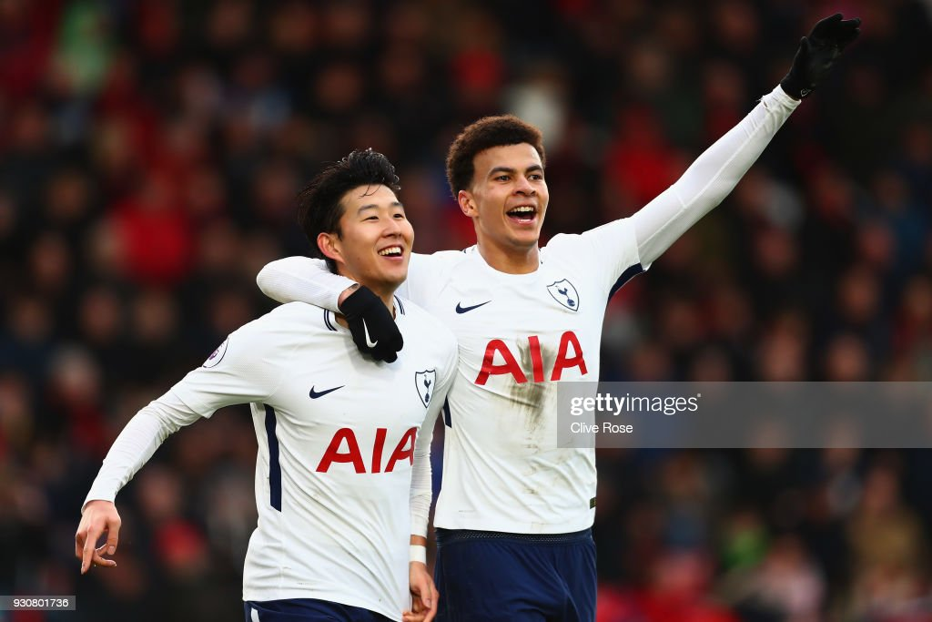Heung-Min Son of Tottenham Hotspur celebrates after scoring his sides second goal with Dele Alli of Tottenham Hotspur during the Premier League match between AFC Bournemouth and Tottenham Hotspur at Vitality Stadium on March 11, 2018 in Bournemouth, England.