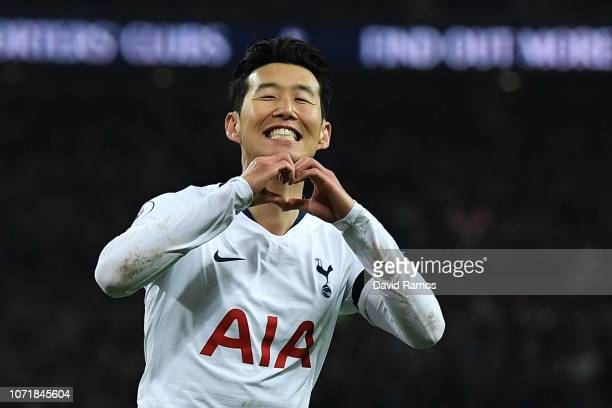 Heung-Min Son of Tottenham Hotspur celebrates after scoring his team's third goal during the Premier League match between Tottenham Hotspur and...