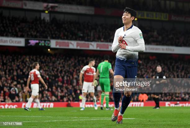 HeungMin Son of Tottenham Hotspur celebrates after scoring his team's first goal during the Carabao Cup Quarter Final match between Arsenal and...