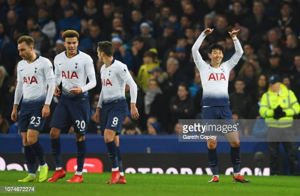 HeungMin Son of Tottenham Hotspur celebrates after scoring his team's first goal alongside team mates during the Premier League match between Everton...
