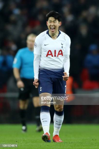 Heung-Min Son of Tottenham Hotspur celebrates after scoring his team's first goal during the Premier League match between Tottenham Hotspur and...