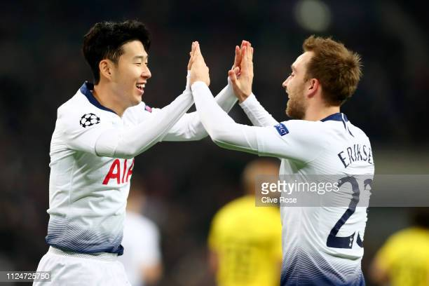 HeungMin Son of Tottenham Hotspur celebrates after scoring his team's first goal with Christian Eriksen of Tottenham Hotspur during the UEFA...