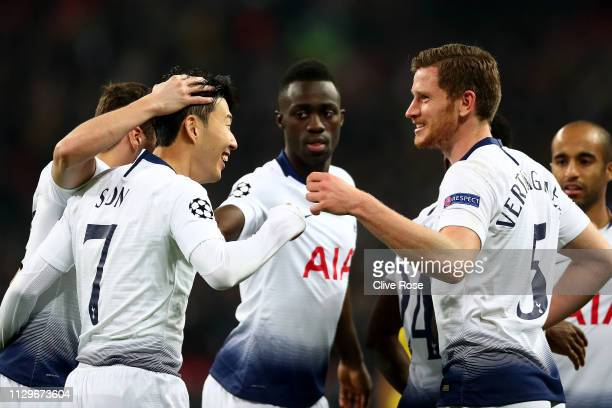 HeungMin Son of Tottenham Hotspur celebrates after scoring his team's first goal with his team mates during the UEFA Champions League Round of 16...