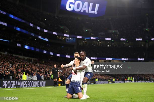 Heung-Min Son of Tottenham Hotspur celebrates after scoring his team's first goal with his team mates during the Premier League match between...