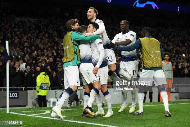 HeungMin Son of Tottenham Hotspur celebrates after scoring his team's first goal with his team mates during the UEFA Champions League Quarter Final...