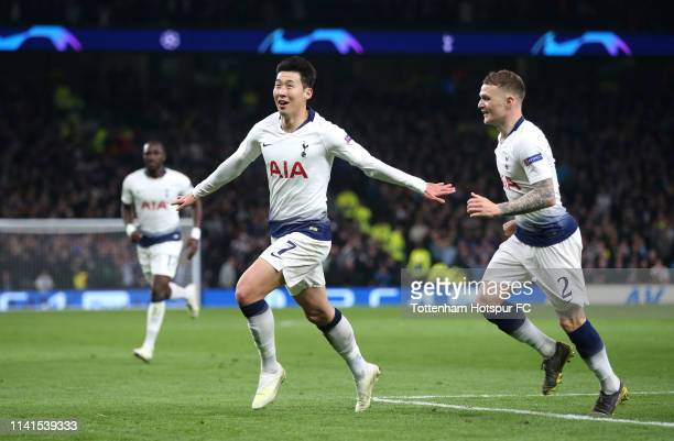 HeungMin Son of Tottenham Hotspur celebrates after scoring his team's first goal with Kieran Trippier of Tottenham Hotspur during the UEFA Champions...