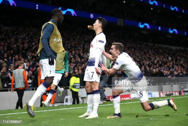 HeungMin Son of Tottenham Hotspur celebrates after scoring his team's first goal with Davinson Sanchez of Tottenham Hotspur and Harry Winks of...