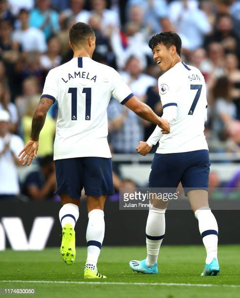HeungMin Son of Tottenham Hotspur celebrates after scoring his team's third goal with Erik Lamela of Tottenham Hotspur during the Premier League...