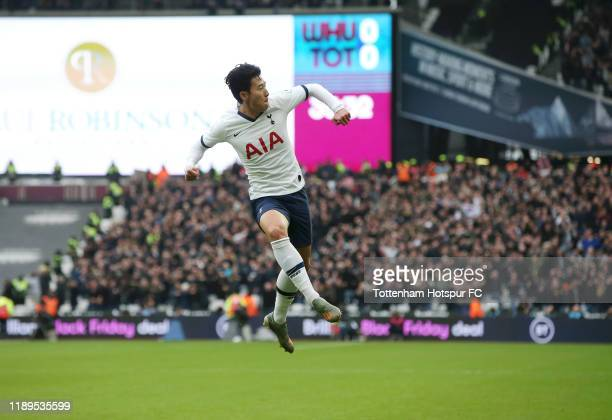 HeungMin Son of Tottenham Hotspur celebrates after scoring his team's first goal during the Premier League match between West Ham United and...