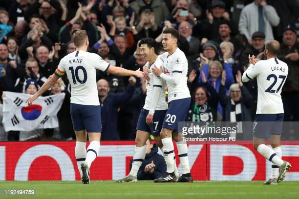 HeungMin Son of Tottenham Hotspur celebrates after scoring his team's third goal with Harry Kane and Dele Alli during the Premier League match...