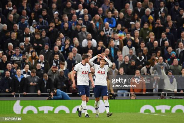 HeungMin Son of Tottenham Hotspur celebrates after scoring his team's third goal with Jan Vertonghen of Tottenham Hotspur during the Premier League...