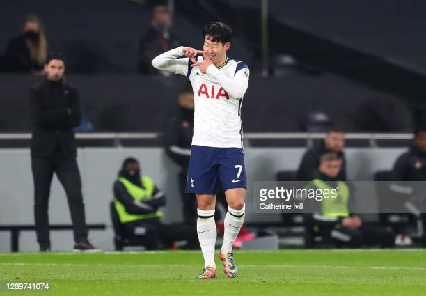 Heung-Min Son of Tottenham Hotspur celebrates after scoring their sides first goal during the Premier League match between Tottenham Hotspur and...