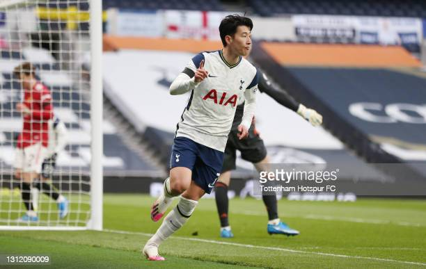 Heung-Min Son of Tottenham Hotspur celebrates after scoring their first goal during the Premier League match between Tottenham Hotspur and Manchester...