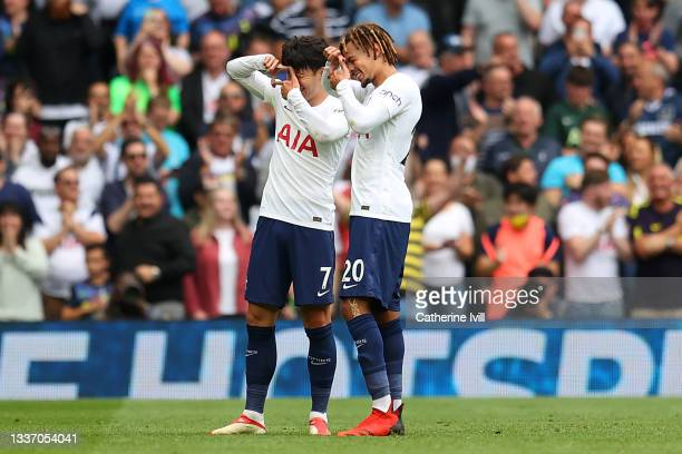 Heung-Min Son of Tottenham Hotspur celebrates after scoring their sides first goal with team mate Dele Alli during the Premier League match between...