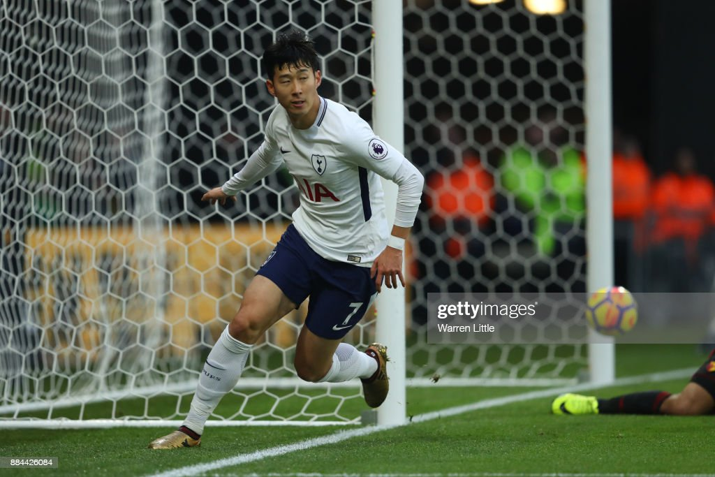 Heung-Min Son of Tottenham Hotspur celebrates as he scores their first goal during the Premier League match between Watford and Tottenham Hotspur at Vicarage Road on December 2, 2017 in Watford, England.