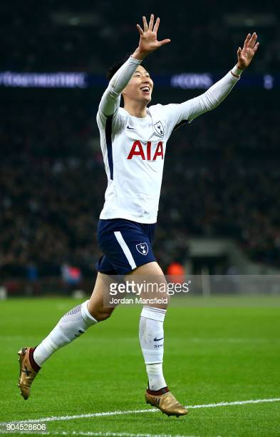 HeungMin Son of Tottenham Hotspur celebrates as he scores their first goal during the Premier League match between Tottenham Hotspur and Everton at...