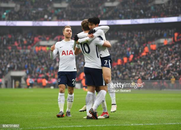 HeungMin Son of Tottenham Hotspur celebrates as he scores their second goal with Harry Kane during the Premier League match between Tottenham Hotspur...