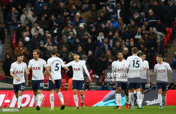 HeungMin Son of Tottenham Hotspur celebrates his sides first goal which came through a own goal by Ryan Shawcross of Stoke City during the Premier...