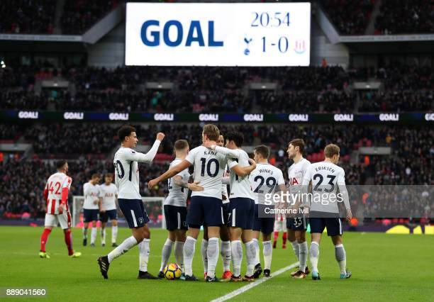 HeungMin Son of Tottenham Hotspur celebrates his sides first goal with his team mates which came through a own goal by Ryan Shawcross of Stoke City...