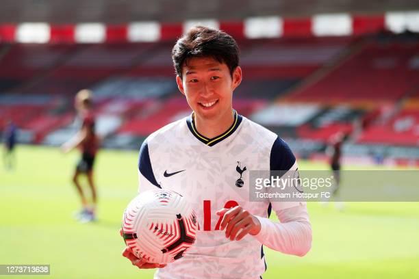 Heung-Min Son of Tottenham Hotspur celebrates post match with the match ball having scored 4 goals during the Premier League match between...