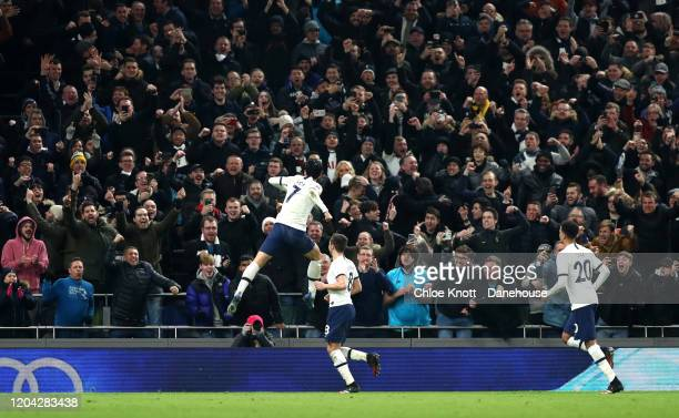 Heung-Min Son of Tottenham Hotspur celebrates scoring a penalty for his team during the FA Cup Fourth Round Replay match between Tottenham Hotspur...