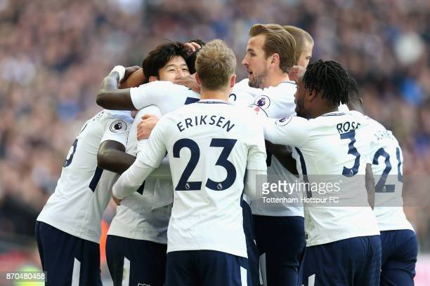 HeungMin Son of Tottenham Hotspur celebrates scoring his sides first goal with his Tottenham Hotspur team mates during the Premier League match...