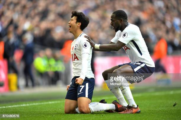 HeungMin Son of Tottenham Hotspur celebrates scoring his sides first goal with Moussa Sissoko of Tottenham Hotspur during the Premier League match...