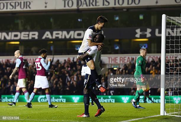 HeungMin Son of Tottenham Hotspur celebrates scoring his sides second goal with Moussa Sissoko of Tottenham Hotspur during The Emirates FA Cup Third...