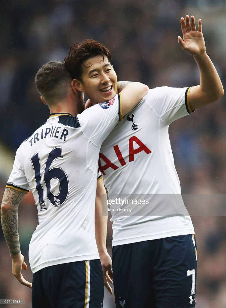 Heung-Min Son of Tottenham Hotspur (R) celebrates scoring his sides second goal with Kieran Trippier of Tottenham Hotspur (L) during The Emirates FA Cup Quarter-Final match between Tottenham Hotspur and Millwall at White Hart Lane on March 12, 2017 in London, England.