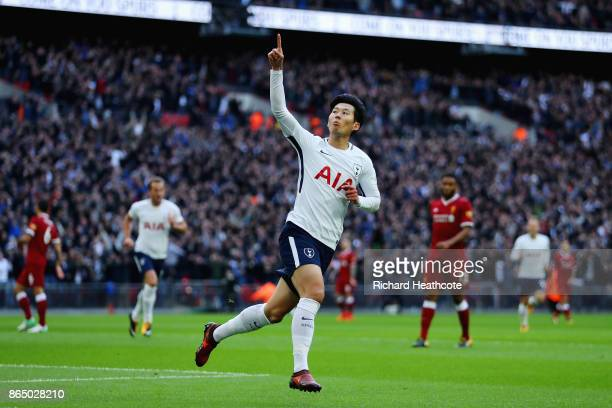 HeungMin Son of Tottenham Hotspur celebrates scoring his sides second goal during the Premier League match between Tottenham Hotspur and Liverpool at...