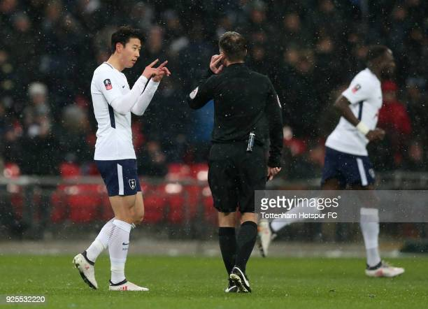 HeungMin Son of Tottenham Hotspur celebrates scoring the opening goal by asking Referee Paul Tierney to review by VAR during the Emirates FA Cup...