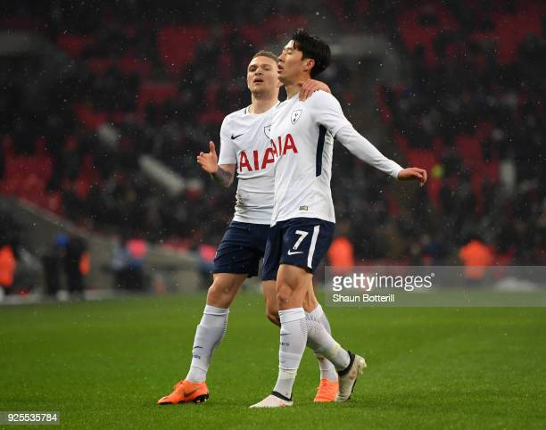 HeungMin Son of Tottenham Hotspur celebrates scoring the opening goal with Kieran Trippier during the Emirates FA Cup Fifth Round Replay match...