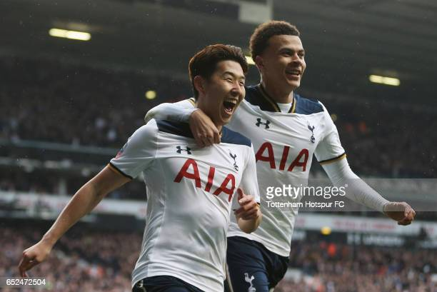 Heung-Min Son of Tottenham Hotspur celebrates with Dele Alli as he scores his sides third goal during The Emirates FA Cup Quarter-Final match between...