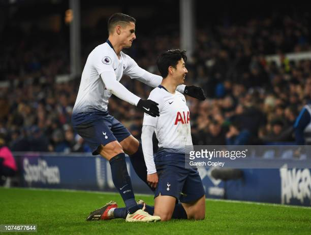 HeungMin Son of Tottenham Hotspur celebrates with Erik Lamela after scoring his team's fifth goal during the Premier League match between Everton FC...