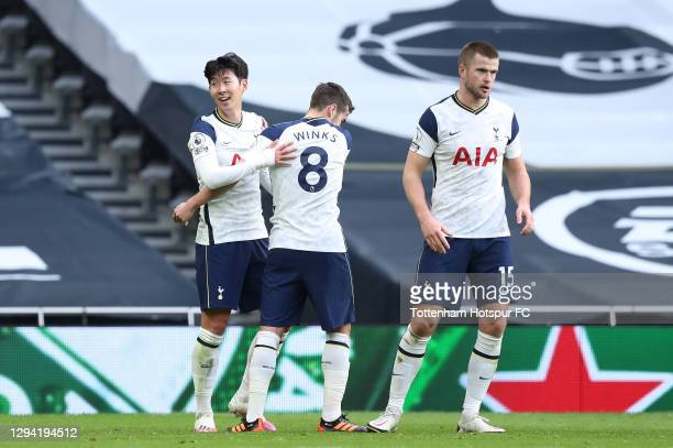 Heung-Min Son of Tottenham Hotspur celebrates with Harry Winks and Eric Dier after scoring their second goal during the Premier League match between...