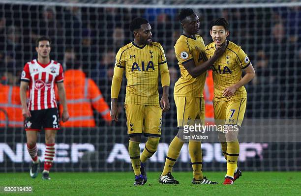 HeungMin Son of Tottenham Hotspur celebrates with team mated Victor Wanyama and Danny Rose of Tottenham Hotspur as he scores their third goal during...