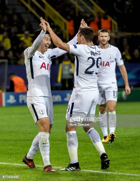 HeungMin Son of Tottenham Hotspur celebrates with team mates after scoring his team's second goal during the UEFA Champions League group H match...
