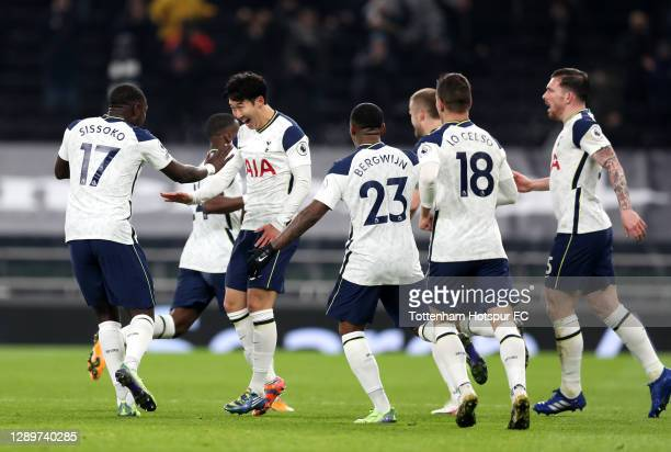 Heung-Min Son of Tottenham Hotspur celebrates with team mates Moussa Sissoko , Steven Bergwijn and Giovani Lo Celso after scoring their sides first...