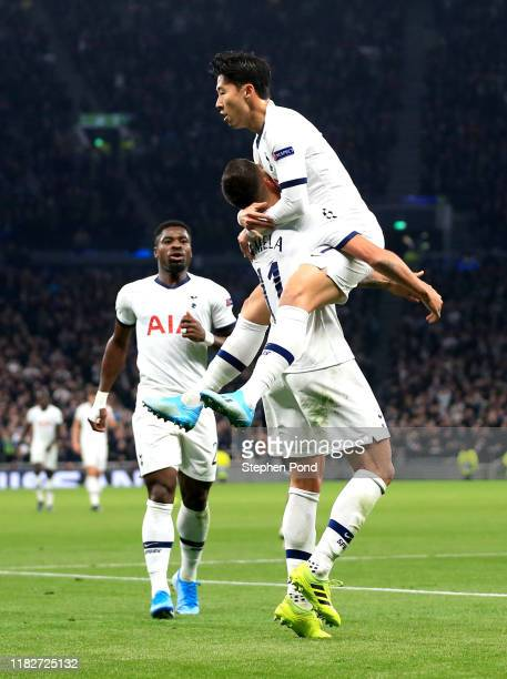 Heung-Min Son of Tottenham Hotspur celebrates with teammate Erik Lamela after scoring his team's second goal during the UEFA Champions League group B...